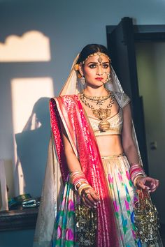 "All ready to get married! I'm not very good with jewelry, so it had to be kept simple, by our ""Delhi"" standards. For the wedding I decided to not wear too many stones, and stick to South Indian temple jewelry. It took us a very long time to find each piece and put it together in a way that worked. Even though it isn't necessarily tradition, I wanted to wear a nath or a nosering. They're very Indian and beautiful."