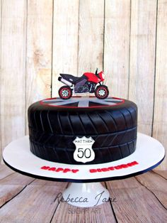 I made this motorbike cake a couple of week's ago for a 50th birthday. The topper is a model of the birthday boy's new bike. Apparently he loved it and took heaps of photos of it :-) The flavour was sticky date cake with salted caramel buttercream...