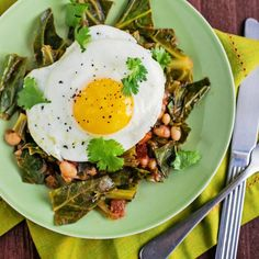 Perfect for Meatless Monday: Cilantro & Tomato Braised Collard Greens with Sunny-side Up Eggs. Healthy, low carb and delicious.