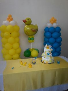 Rubber Ducky balloon column, yellow and blue baby bottle balloon columns Sheila Moody's Balloons & More Clinton, MS