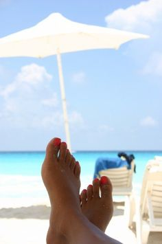 Cancun, Mexico, this is the kind of place I'd like to be right now.  White sand beach, crystal blue water, an umbrella and a beach chair :)