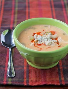This Buffalo Chicken Soup is cheesy, filling and perfect winter comfort food. Just 213 calories or 6 Weight Watchers SmartPoints per serving! www.emilybites.com