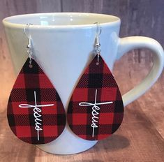 Buffalo plaid faux leather earrings with Jesus in Cross design. Handmade by me. Pink Tassel Earrings, Diy Leather Earrings, Bar Stud Earrings, Diy Earrings, Leather Jewelry, Boho Jewelry, Earrings Handmade, Handmade Jewelry, Handmade Leather