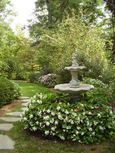 Nice green, lush landscaping. Ask Down to Earth today regarding our large fountain collection.