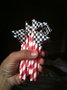 Race car themed cupcake toppers for boy's birthday! Cut paper straws in half; cut triangles out of patterned paper and glue together. Cost: $6. Done.