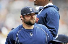 Detroit Tigers relief pitcher Joba Chamberlain is seen in the dugout before the first inning of a baseball game against the...
