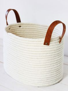 Traditionally, rope baskets are stitched together -- and often costly. That's why we love the simple yet beautiful DIY version that twin sisters Sara and Melissa share on their blog, Alice & Lois. Their no-sew rope basket is perfect for lightweight storage (think yarn and stuffed animals), while the coil pattern adds beautiful texture to any room.