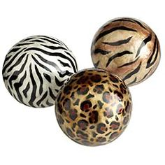 Animal Print Capiz Spheres glued to rock tile bases = bookends for  a black bookcase