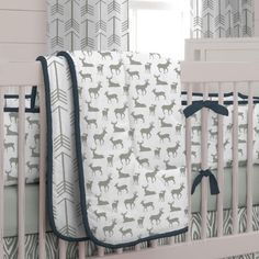 "Crib Bedding Comforter in Navy and Gray Deer by Carousel Designs.  Lullaby and goodnight! Our soft and cozy box-quilted comforter will keep your baby toasty warm on a chilly night, and makes for a great tummy-time mat by day. Measures approximately 36"" wide by 46"" long. Our crib comforter batting is made from recyclable hypoallergenic polyester fiberfill."