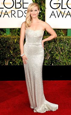 Reese Witherspoon The Best Actress nominee, for her role in Wild, posed in a strapless, beaded Calvin Klein dress and diamond jewels.