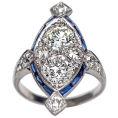 1920s Art Deco Sapphire Diamond Platinum Two Stone Engagement Ring | From a unique collection of vintage engagement rings at https://www.1stdibs.com/jewelry/rings/engagement-rings/
