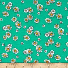 Jersey Knit Daisy Green from @fabricdotcom  This jersey knit fabric features a smooth hand and 50% stretch across the grain. This versatile fabric is perfect for making T-shirts, loungewear, yoga pants, skirts, dresses and more! Colors include green, white and yellow.