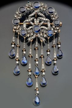 A Belle Epoque Pendant brooch of gold & silver with diamonds & sapphires.