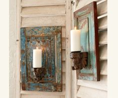I see a DIY project here! Recycled small cabinet fronts...a distressed paint finish, pillar candles and maybe even use curtain corbels for the candle stand?! I will definitely put this on my project list!