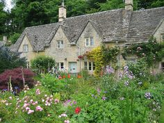 I'd love to have this cottage garden--along with the cottage. All those wonderful flowers creeping along the side of the house. garden design decorating before and after decorating Beautiful Gardens, Beautiful Homes, Beautiful Places, Cottage Living, Cottage Style, Cozy Cottage, Dream Garden, Home And Garden, Modern Garden Design