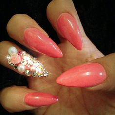 Coral stilettos with gems.