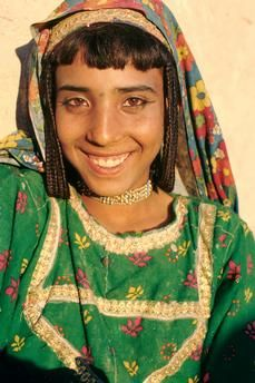 SOUTHERN AFGHANISTAN. 1978. Portraits of Baloch women and girls in traditional clothes. Photographs by Roland and Sabrina Michaud.