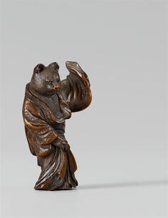 A fine wood netsuke of a cat, by Masatoshi. Late 19th century, Auktion 1044 Asiatische Kunst, Lot 957