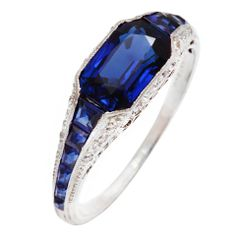 Art Deco TIFFANY Sapphire Diamond Platinum Ring  USA  1920s  Sapphire and diamond ring set in platinum by Tiffany and Company.  Price  $25,000  Condition*  Very good.  Measurements  contact dealer  Specifications  Metal: Platinum  Creator: Tiffany and Co.    *drool*