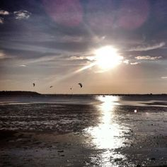 Evening kite-surfing at Sandbanks. With genuine lense flare.