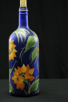 This hand painted Sunflower Bottle is a great piece for any time of the year. Bright, Bold and Cheery Sunflowers on a cobalt blue background make a Wine Bottle Art, Painted Wine Bottles, Lighted Wine Bottles, Blue Bottle, Bottle Lights, Wine Bottle Crafts, Bottles And Jars, Jar Crafts, Decorated Bottles