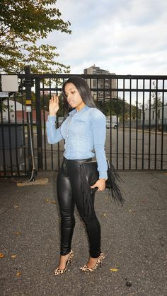 i would wear a leather skirt instead of these pants, umm sweety it looks like they are either busting or the zipper is undone!!!!!