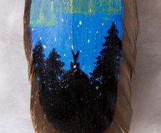 hand painted feather jewelry: rabbit and northern lights by hoyhenenkevytta on Etsy