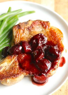 These are the best pan fried pork chops! Simply seasoned bone-in chops are treated with an extra special thyme and cherry pan sauce to make weeknight dinner seem like a weekend affair! On the table start to finish in 45 minutes. Beef Chops, Pan Fried Pork Chops, Fried Beef, Simply Recipes, Sweet Recipes, Pan Sauce Recipe, Cherry Salsa, Best Pans, Frozen Cherries