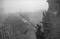 1945: The picture holds both, aesthetic as well as historic value. A Soviet Red Army soldier raises the Soviet flag above the Reichstag, Berlin.
