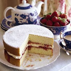 Victoria Sponge Cake      This delicious layer cake, popular at afternoon teas in England, was named in honor of Queen Victoria. It eschews cloying frosting for a shower of confectioners' sugar and a filling of whipped double Devon cream with strawberry jam.