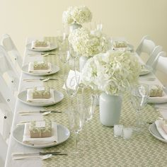Here's a quick and inexpensive way to add style to your reception space: Use gift-wrap runners.  It says to wrap favor box tops in the same paper, but a simple belly band would be much faster with similar impact