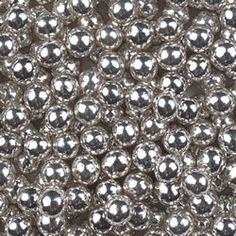 Fancyflours.com has truly edible ball bearings by mail order in a rainbow of sizes and colors. 4mm Dragees Silver, 2 oz jar
