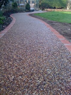 Recently we have been trained in laying resin bound gravel surfacing the look and benefits are fantastic!  Resin bound and bonded gravel . Resin Driveway, Gravel Driveway, Driveway Landscaping, Walkway, Pebble Driveway, Driveway Ideas, Rock Driveway, Unique Gardens, Beautiful Gardens