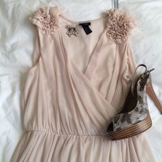 H&M cream colored dress with shoulder detail You will be an ethereal beauty in this dress! Great shoulder detail! 32 inches long. 100% polyester. H&M Dresses