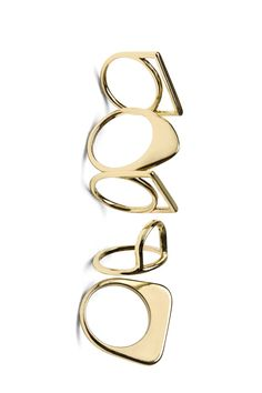 Set of five thin rings in varying mod-inspired shapes and in gold-toned metal. Also stackable.