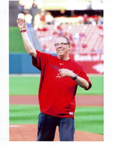 A closeup of Steve Schmitt, Madison College alum, throwing out the first pitch for the St. Louis Cardinals