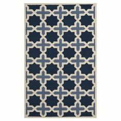 Hand-tufted of soft wool, this stylish rug showcases a Moroccan tile-inspired motif for a touch of exotic appeal.  Product: RugConstruction Material: WoolColor: Light blue and ivoryFeatures: Handmade in India Note: Please be aware that actual colors may vary from those shown on your screen. Accent rugs may also not show the entire pattern that the corresponding area rugs have.Cleaning and Care: Professional cleaning recommended