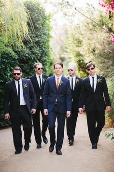 sharply dressed men in black (and blue)   Photography by docuvitae.com   Event Planning + Design by bashplease.com   Floral Design by brownpaperdesign.com   Read more - http://www.stylemepretty.com/2013/06/24/palm-springs-wedding-from-docuvitae-bash-please/