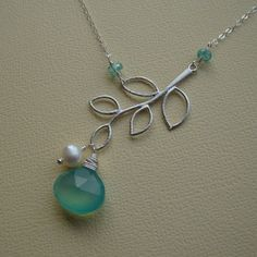 I might like this even better, with the pop of color.  Pretty dainty necklace with branch.  :)