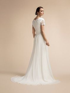 Moonlight Modesty is romantic light weight chiffon wedding dress with lace short sleeves and v-neckline. Wedding Dress Backs, Wedding Dress Sleeves, Modest Wedding Dresses, Lace Dress, Dresses With Sleeves, Short Sleeves, Beaded Wedding Gowns, Bridal Gowns, Cloud 9