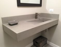 Wall hung concrete bathroom sink with a custom ramp sink by Trueform Concrete #TrueformConcrete #OurSinks
