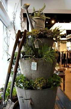 Stacked Galvanized Planters... LOVE the watering can topper!