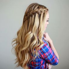 braided half up half down with loose waves prom hair
