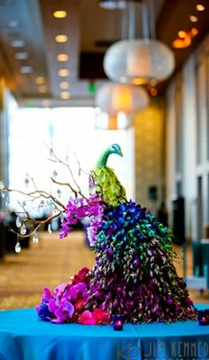 Love the centerpiece, different yet very colorful, could work for a lush lunch event