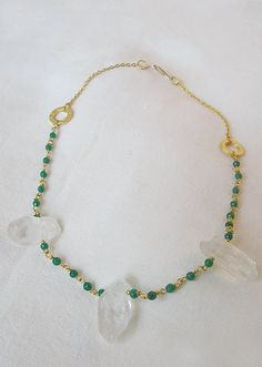 SOLD A One of a Kind, handmade gold plated rosario type chain necklace full with beautiful green Jade gemstone beads, three gorgeous clear quartz crystals, 22K gold plated matte connecting links and 24K gold plated thin chain!  It closes at the back with a gold plated  hook clasp.  Just fab! Is it for your neck?!..  It is wrapped in a beautiful gift box and can be send to you or to whomever you like in 1-2 business days!