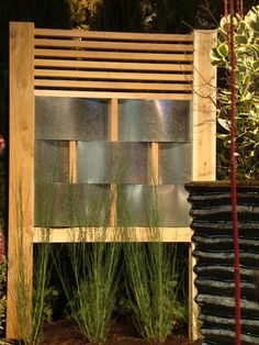 fence panel with woven metal flashing