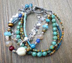 Birds. Charm bracelet with stone, Czech glass, glass seed beads and silver metal jewelry.