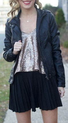 Holiday fashion sequin top, pleated skirt and leather coat
