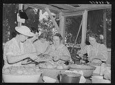 Parishioners peeling and slicing tomatoes for a benefit picnic supper on the grounds of Saint Thomas' Church. Near Bardstown, Kentucky. Photographer Marion Post Wolcott Created August 1940.