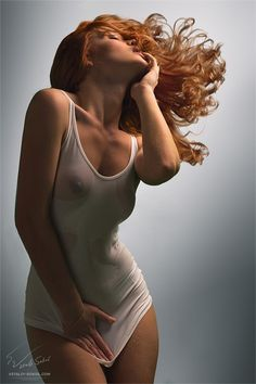 Sexy redhead wearing see through top. More sexy women models at http://sexy-calendars.net